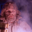 Kurt Russell holding dynamite and a flare in John Carpenter's The Thing